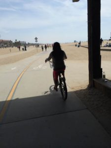 bicycling under the Santa Monica Pier